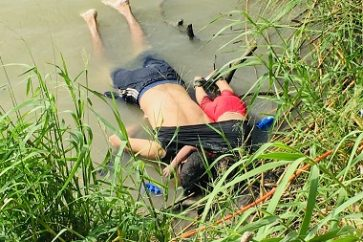 ADDS THAT PHOTO WAS FIRST PUBLISHED IN MEXICAN NEWSPAPER LA JORNADA - EDS NOTE: GRAPHIC CONTENT - The bodies of Salvadoran migrant Oscar Alberto Martínez Ramírez and his nearly 2-year-old daughter Valeria lie on the bank of the Rio Grande in Matamoros, Mexico, Monday, June 24, 2019, after they drowned trying to cross the river to Brownsville, Texas. Martinez' wife, Tania told Mexican authorities she watched her husband and child disappear in the strong current. This photograph was first published in the Mexican newspaper La Jornada. (AP Photo/Julia Le Duc)